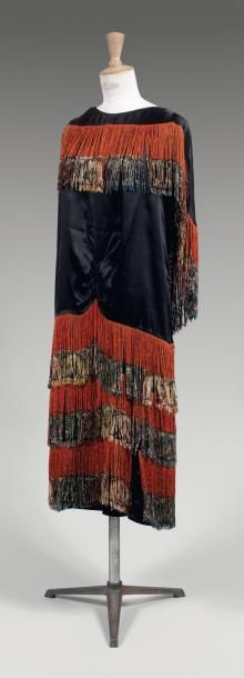 Paul Poiret, haute couture, Russian-inspired dress in black silk, fringed with orange silk, c. 1920/1923