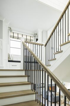 Staircase Ideas Staircase with White Oak Staircase features White Oak handrail with metal balusters and White Oak treads in a custom stain to match the hardwood flooring Walls feature a classic Board and Batten paneling Staircase Ideas Staircase with White Oak Staircase features White Oak handrail with metal balusters and White Oak treads in a custom stain to match the hardwood flooring Walls feature a classic Board and Batten paneling Staircase Ideas Staircase with White Oak Staircase…