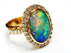 Opal and diamond ring, the opal is from Andamooka in Australia