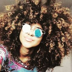 How long do you think her hair would be if we straightened out those curls? then again, WHY would we?  #longhairdontcare #naturalhair #allnatural #myhairevolution #vitmans #hairskinnails #curlyhair #afro #curlyafro #naturalcurls