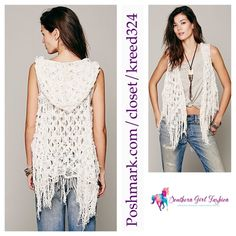 """Cozy White Sweater FREE PEOPLE Crochet Cardigan Size Small. New without tags. $148.00   Ivory hooded best with open knit detailing throughout.  Fringe hem. Front clasp closure.  Cotton, nylon.    Measurements for Size Small: Bust: 42"""" Length: 33""""   ❗️ Please - no trades, PP, holds, or Modeling.    Bundle 2+ items for a 20% discount!    Stop by my closet for even more items from this brand!  ✔️ Items are priced to sell, however reasonable offers will be considered when submitted using the…"""