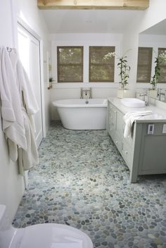 Island Stone Birds Egg Blend Pebble Tile really defining the palette of this beautiful bathroom