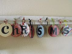 old c.d's with scrapbook paper.  Great nursery decore!