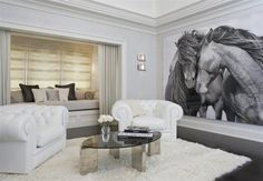 Peaceful and wild... Love the grey tones and the giant horse wall mural. Would prefer the sofas in a darker tone...