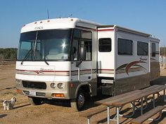 A Class A motorhome with slide-out extended floors