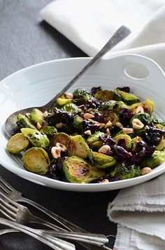 [Caramelized Brussels sprouts with dark cherry sauce + hazelnut.]