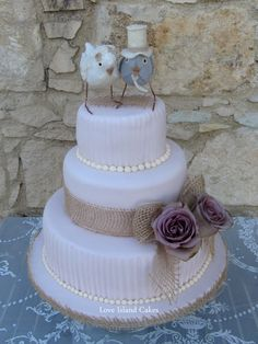 rustic wedding cake with burlap and bird topper