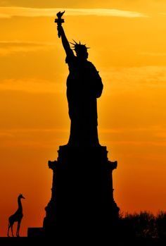 A silhouette of the Statue of Liberty in New York. Famous monuments are often identified by their silhouettes. Silhouette Images, Silhouette Vector, Liberty New York, Staten Island Ferry, Famous Monuments, Smile Images, Silhouette Photography, Glow, Sea To Shining Sea