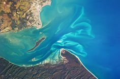 Some of the richest ecosystems on Earth are estuaries, where freshwater and saltwater collide with the tides. The Great Sandy Strait is an estuary that separates the coastline of the state of Queensland, Australia, from neighboring Fraser Island. Nasa, All About Water, Fraser Island, Sand And Water, Earth From Space, Image Of The Day, Sunshine Coast, Marine Life, Mother Earth