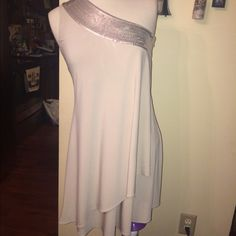Calvin Klein dress Size 2 beige and sequins dress by Calvin Klein. One strap and a zipper on the side has a layer of fabric that extends out so when you step out and twirl, it will twirl with you!! It will be a show stopper on you! Calvin Klein Dresses Mini