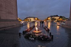 Eternal Flame Burns at Tomb of the Unknown Soldier at Arc de Triomphe, Paris, France