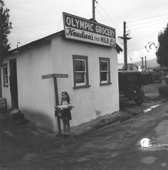 Girl in front of the Olympic Trailer Court grocery store, 2121 Bundy Drive, Santa Monica, California, USA (by Ansel Adams), circa 1940
