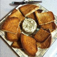 Pieces of Bread Around Herb-Crusted Goat Cheese. #goatvet likes these simple instructions for making goat cheese