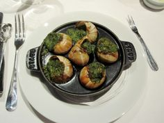 Escargot- French - An edible snail, especially one prepared as an appetizer or entree. I like as appetizer