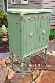 A repurposed music cabinet newly painted and heavily distressed.: