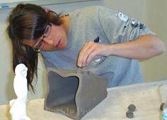 making hand built clay vase