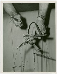 Marionettes - Close-up of hands.  Source:  NYPL Digital Gallery