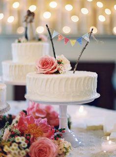 cake with florals + rustic bunting // photo by Tec Petaja, design + florals by Cedarwood Weddings  // View more: http://ruffledblog.com/elegant-nashville-wedding/