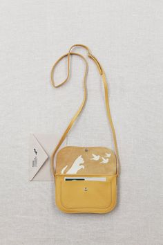 Add a little yellow in your street style wear with the Keecie Cat Chase Bag Yellow
