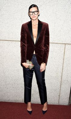 Jenna Lyons wearing a velvet blazer, satin pants, and point-toe heels