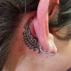 New Zealand Maori Silverfern tattoo behind ear