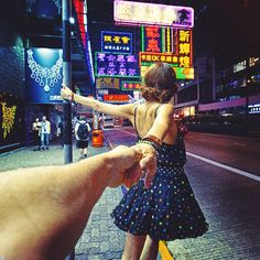 A Photographer's Stunning Pictures of His Girlfriend Leading Him Around theWorld