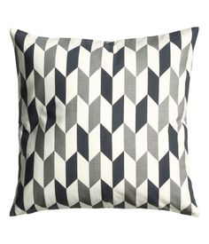 Cushion cover in cotton fabric with a printed design at front. Solid color at back and concealed zip. Size 20 x 20 in.