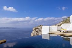 Azzurro Suites || Perched on the volcanic cliffs of Fira, Azzurro Suites offers accommodation with views over the caldera and the Aegean Sea. It has an infinity pool and a lounge bar at the top of the property.