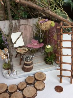 Garden Fairy Cottage by Olive~ Includes All Items Included Handmade Fairy Cottage/House includes ~Fairy Lights ~ Fairy Bed with cashmere blanket and pillow ~ Painters Easel ~pallet and brushes ~ Seed Harvesters Basket ~Watering Can (hand sculpted) ~Mushrooms (hand sculpted)