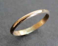 Hey, I found this really awesome Etsy listing at https://www.etsy.com/listing/96902767/14k-gold-filled-ring-simple-2mm-band