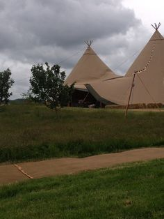 The Wonderful Tipis from World inspired Tents in front of our orchard. http://www.worldinspiredtents.co.uk