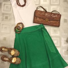 """Zara Green Linen Skirt Zara Green Linen Skirt  • Excellent condition • Gently Worn  • Size: M  • Fully Lined • Side Pockets • Faux Wrap Belt ~ ties on side • Color: Green Shell: • 100% Linen Lining: • 100% Rayon Dry Clean Only  • 28"""" Waist ~ 24"""" Length  Super cute Zara green linen Spring Fling Skirt! Zara Skirts Mini"""