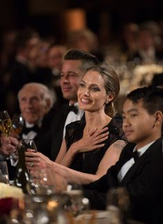 Angelina Jolie and two of her men, partner Brad and son Maddox.