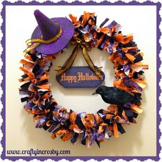 I'll have to make one! Dollar Store here I come Crafty In Crosby: Halloween Wreath