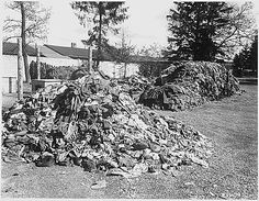 This pile of clothes belonged to prisoners of the Dachau concentration camp, recently liberated by troops of the U.S. Seventh Army. Slave laborers were compelled to strip before they were killed. Germany. 4/30/1945