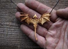 Dragon pendant. Carved with just one knife from ancient English Oak By Giles Newman.