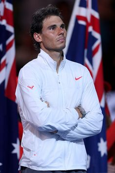 Rafael Nadal Photos - Rafael Nadal of Spain looks on as Stanislas Wawrinka of Switzerland is presented the Norman Brookes Challenge Cup during day 14 of the 2014 Australian Open at Melbourne Park on January 26, 2014 in Melbourne, Australia. - 2014 Australian Open - Day 14
