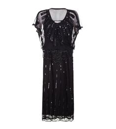No need to stick with mini skirts to get the flapper look. This Gatsby Style Maxi Dress in Black still evokes the Great Gatsby era, without baring quite so much leg
