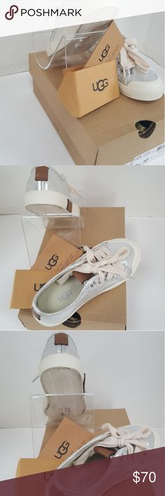 UGG Australia Girls Mikki Sneaker Sterling Size 10 UGG Australia Girls Mikki Sneaker Sterling Size 10  Canvas rubber sole She's sure to shine with each step she takes in this ultra-cool sneaker by UGG? Kids. Metallic canvas upper with logo-stamped tabs for a preppy look. Lace-up closure. Canvas lining. EVA foam-cushioned insole. Rubber outsole. Measurements: Weight: 6 oz Product measurements were taken using size 10 Little Kid, width M. Please note that measurements Size 10 UGG Shoes…