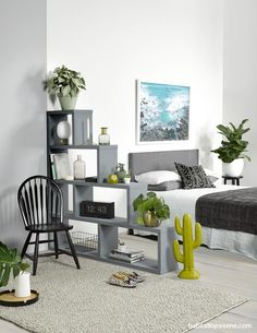 A beautiful example of small space living, this room is painted in two halves, ReseneHalf Grey Chateau (left) and ReseneSea Fog, to delineate the bedroom a...