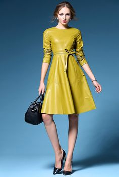 Most women focus their wardrobes around traditional, linear garments, resulting in a bland and uninspired appearance. However, how often do you see a long-sleeve yellow leather dress? It is already rare to see a black leather dress, so why not yellow? Faux Leather Dress, Black Leather Dresses, Yellow Leather, Yellow Black, Pu Leather, Big Black, Leather Skirt, Unique Dresses, Yellow Dress