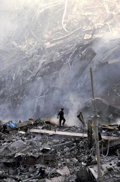 9/11 Rescue workers search a mountain of wreckage after the collapse of the World Trade Center's Twin Towers.