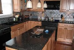 The black marbled countertops tie the entire kitchen together nicely, and should be easy to use and clean.