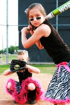 Oh, I need to take a picture of Madison and Reagan like this. How adorable. Softball girls are pretty, too. :)