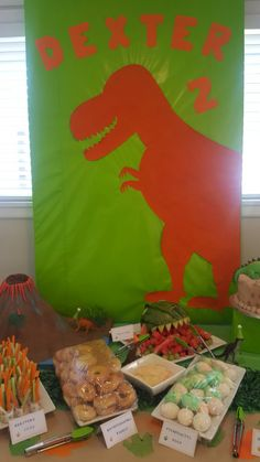 Dinosaur backing board, easy dino cut out, paper mache volcano and the start of the food table.