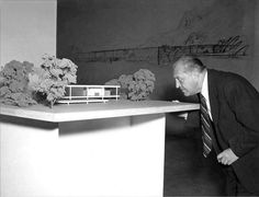 Ludwig Mies van der Rohe studying the model of the The Farnsworth House