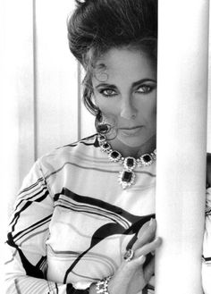 Elizabeth Taylor wearing Pucci and the Bulgari emeralds Richard Burton bought her during the filming of Cleopatra in Rome.