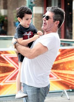 Family day: Simon Cowell arrived at the X Factor auditions in east London on Thursday accompanied by his son Eric