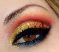 Sunset inspired gold, red, orange and blue dramatic eye make up. Again, I'd like to point out all of the skeptics who rolled their eyes at me for sunset inspired eye makeup LAST year.