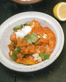 """Cook delicious chicken tikka masala, a classic Indian dish, at home with this tasty recipe from chef Jamie Oliver's cookbook, """"Jamie's Food Revolution.""""   Photo credit: David Loftus and Chris Terry"""